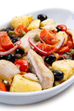 Mackerels with potatoes,tomatoes,capers and olives Stock Photo