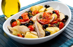 Mackerels with potatoes,tomatoes,capers and olives Royalty Free Stock Photography