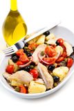 Mackerels with potatoes,tomatoes,capers and olives Royalty Free Stock Images