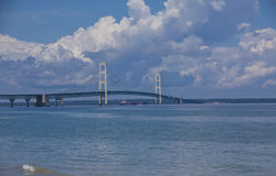 Mackinac Bridge. Photo of the Mackinac Bridge which joins the two peninsulas of Michigan. There was a ship going under the bridge as the photo was taken Royalty Free Stock Photography