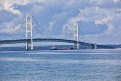 Mackinac Bridge. Photo of the Mackinac Bridge which joins the two peninsulas of Michigan. There was a ship going under the bridge as the photo was taken Royalty Free Stock Photos