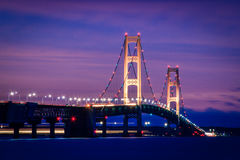 Mackinac Bridge Twilight. The tall towers of Michigan's majestic Mackinac Bridge shine brightly as the evening sky glows with shades of purple during twilight Royalty Free Stock Image