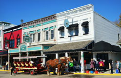 Mackinac Island. A horse and carriage sit in front of Horns Bar and Millies on Main in Mackinac Island in the Upper Peninsula of Michigan.  Tourists roam the Stock Photography