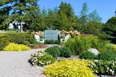 Flower gardens and sign of Mission Point Resort on Mackinac Island royalty free stock images
