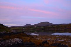 MacLeod's Tables at Dawn. Pretty pink skies at dawn over loch Dunvegan Stock Photos