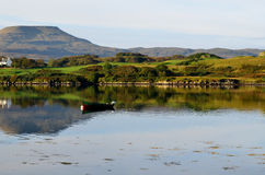 MacLeod's Tables Reflected in the Loch. On the Isle of Skye MacLeod's Tables reflected in Loch Dunvegan Stock Images