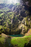 Macocha Abyss. The Macocha Abyss, also known as the Macocha Gorge, is a sinkhole in the Moravian Karst cave system of the Czech Republic located north of the stock photography