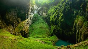 Macocha Abyss, Moravian Karst microclimate with juicy greenery and a small lake. Czech Republic Macocha Abyss, Moravian Karst microclimate with juicy greenery royalty free stock images