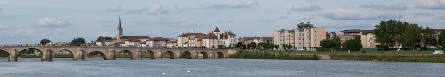 Macon and Pont Saint-Laurent, France. A panorama of Macon and Saint-Laurent Bridge viewed from a cruise ship on the Saone-et-Loire Ain tributary of the Rhone stock photography