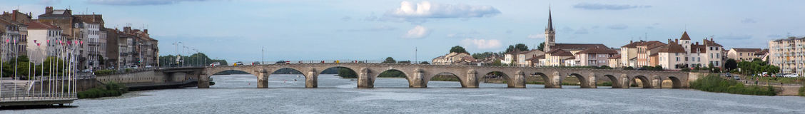 Macon and Pont Saint-Laurent, France. A panorama of Macon and Saint-Laurent Bridge viewed from the Saone-et-Loire Ain tributary of the Rhone stock photography