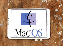 MacOS operating system logo. Logo of mac OS operating system on samsung tablet on wooden background Royalty Free Stock Photos