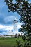 Macquarie Lighthouse Vaucluse South Head Sydney Australia under cloudy skies. With tree in foreground Stock Images