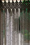 Macrame curtain. White macrame curtain made with rope. Handmade craftwork Royalty Free Stock Image