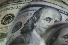 Macro étroit du visage du ` s de Ben Franklin sur les USA 100 dollars Images stock