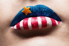 Macro 4th july lips. With american flag makeup on it Stock Photo