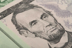 Macro of Abraham Lincoln on five USA dollar banknote Royalty Free Stock Images