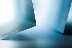 Macro, abstract, background picture of blue paper on paper background Stock Photo