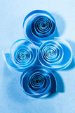 Macro, abstract, background picture of blue paper spirals on paper background. Macro, abstract, background picture of blue paper spirals on paper blue background royalty free stock image