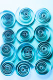 Macro, abstract, background picture of blue paper spirals on paper background. Macro, abstract, background picture of paper spirals on paper background royalty free stock images