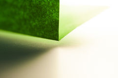 Macro, abstract, background picture of a green paper on paper background Royalty Free Stock Photos