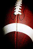 Macro of an American football. Against a dark background Royalty Free Stock Photos
