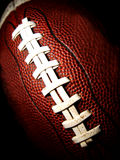 Macro of an American football vertical. American football against a dark background Royalty Free Stock Image