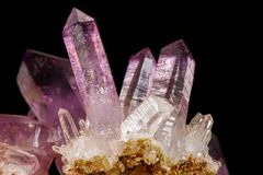 Macro of amethyst mineral stone on black background. Close up stock photos