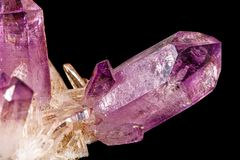 Macro of amethyst mineral stone on black background. Close up royalty free stock photo