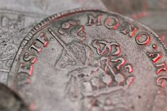 Macro of ancient silver medieval coin. Macro photo of an ancient silver medieval coins stock photography