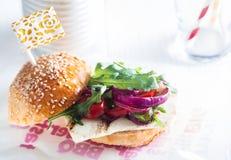 Macro Appetizing Veggy Burger on Table Stock Photo