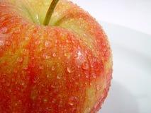 Macro apple. Raindrops on the apple Royalty Free Stock Photography