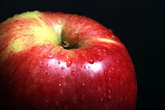 Macro apple texture with water Royalty Free Stock Images