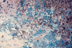 Macro artist`s palette, texture mixed oil paints in blue colors. royalty free stock photo
