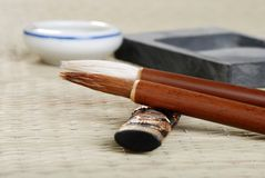 Macro asian calligraphy brush with accessories Stock Photos