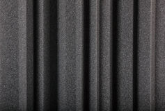 Macro background of acoustic foam wall. Black gray microfiber foam insulation for noise in music studio or acoustic halls , rooms or houses , professional studio royalty free stock photography