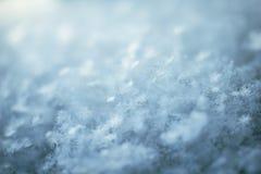 Snowflake close up. Macro background of fresh snowflake texture on a blur Royalty Free Stock Photo