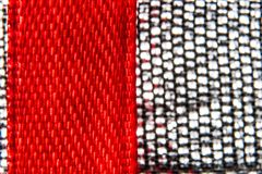 Macro background of red tape and metal fabric royalty free stock photo