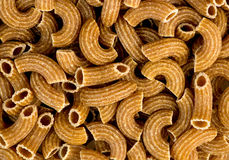 Macro background texture of wholemeal ribbed uncooked macaroni Royalty Free Stock Images