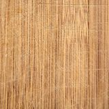 Macro bamboo wood grain cutting board with knife marks, well used in kitchen. stock photography