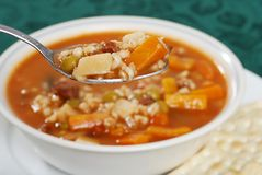 Macro beef barley soup in a spoon Royalty Free Stock Photo