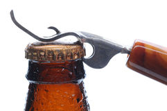 Macro Beer Bottle and Opener Royalty Free Stock Images