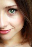 Macro big green eye of girl. Macro green eye and lips of beautiful girl Stock Image