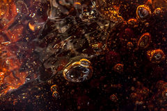 Macro black bubbles  on the glass wall of cola Royalty Free Stock Image