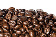 Macro black coffee beans. Isolated on white background Royalty Free Stock Photography