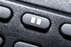 Macro Of A Black Pause Button On Black Remote Control For A Hifi Stereo Audio System Stock Photography