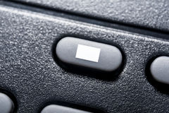 Macro Of A Black Stop Button On Black Remote Control For A Hifi Stereo Audio System Stock Photo