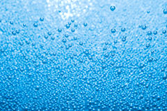 Macro of blue air bubbles in water Stock Photos