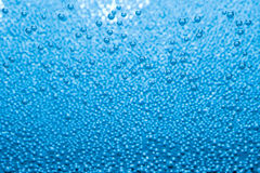 Macro of blue air bubbles in water Royalty Free Stock Images
