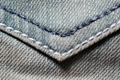 Macro of blue jeans back pocket Royalty Free Stock Image