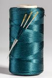 Macro blue spool of thread with needles Royalty Free Stock Photography